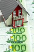 Residential house on bills — Stock Photo