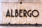 Sign albergo — Stock Photo