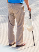 Tourist with cap and walking stick — Stock Photo