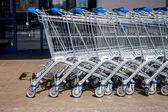 Shopping cart in front of a supermarket — Stock Photo