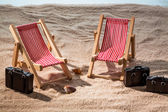Deck chair on sandy beach — Stock Photo