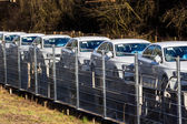 New car on a freight train — Stock Photo