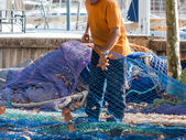 Fishing nets repaired — Stock Photo