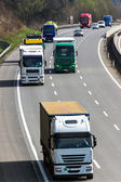 Trucks on the highway — Stock Photo