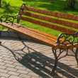 Wet park bench — Stock Photo