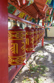 Prayer wheels with mantra, Sanskrit text — Stock Photo