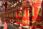 Prayer wheels with mantra, Sanskrit text — Stock Photo