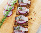 Piece of herring on a slice bread — Stock Photo