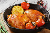 Fried chicken thigh in a pan — Stock Photo