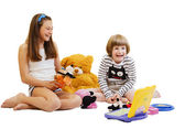 10-12 years girl and boy playing with toys 5-6 years — Stock Photo