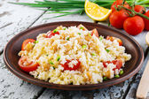 Couscous with chickpeas and cherry tomatoes — Foto de Stock