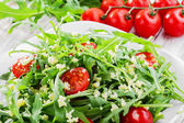 Couscous salad with arugula and cherry tomatoes — Стоковое фото
