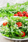 Couscous salad with arugula and cherry tomatoes — Stock Photo