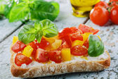 Bruschetta with tomatoes and bell peppers — Stock Photo