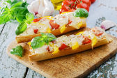 Bruschetta with tomatoes and bell peppers mozzarella — Stock Photo
