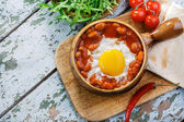 Baked eggs with beans for Mexican — Stock Photo