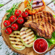 Grilled Pork Chops with vegetables — Stock Photo #48176433