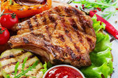 Grilled Pork Chops with vegetables — Stock Photo