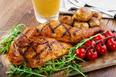 Grilled chicken with potatoes half — Stock Photo