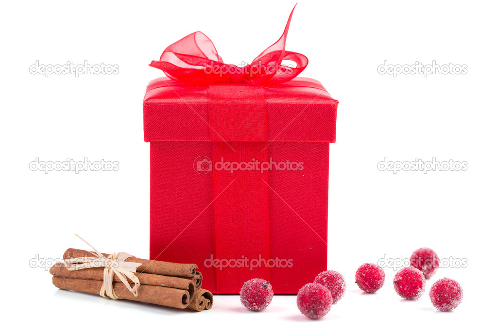 Christmas box  on white background with cinamon — Stock Photo #14512401