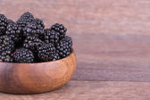 Blackberries in wooden bowl — Stock Photo