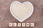 Sesame in cup — Stock Photo