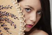 Woman holdind fan — Stock Photo