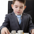 Kid dressed up as a business person — Stock Photo #42337115