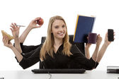 Busy woman at her desk — Stock Photo