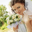 Stock Photo: The bride with a bouquet of flowers.