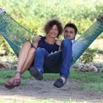 Couple in a tropical garden — Stock Photo