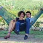 Couple in a tropical garden — Stock Photo #25801639