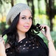Girl in fashionable winter cap — Stock Photo #26382649