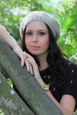 Girl in fashionable winter cap — Stock Photo