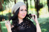 Girl in fashionable winter cap — Stock Photo