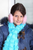 Little girl in pink earmuffs — Stock Photo