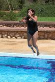 Girl jumping in swimming pool — Stock Photo