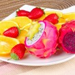 Plate with fresh mixed fruits — Stock Photo