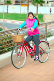 Little girl with her bicycle — Stock Photo