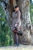 Woman near a tree — Stock Photo
