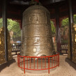 The great historic bell in the park above the statue Dafo — Stock Photo
