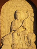 Relief - the stone Buddha - frequent decoration of temples — Stock Photo