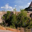 Tourist track San Martin Bridge in Toledo - Stock Photo