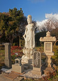 Figure in the park near the temple — Stock Photo