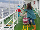 Tourists on a ferry — Stock Photo
