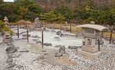 Japanese garden in the onsen (hot springs) — Stock Photo