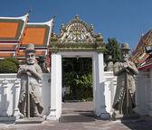 Stone giant in Wat Pho - Bangkok — Stock Photo