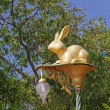 Decorative street lamp with a gold figurine of a rabbit — Stock Photo #40486321