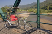 Tricycle on old bridge — Stock Photo