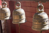 Ornate Buddhist temple bells — ストック写真